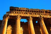 Picture of Baalbeck temple ruins in Heliopolis over clean blue sky background, arabian architecture,