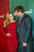PASADENA, CA - JAN. 7: Julie Benz and Grant Bowler arrive at the NBCUniversal 2013 Winter Press Tour