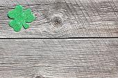 Shamrock on barnboard for announcement