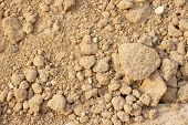 stock photo of loam  - Pile of dry soil at construction site - JPG