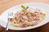 pic of carbonara  - Spaghetti Carbonara on a white plate with ham