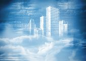 Digitally generated hologram of city in clouds on blue background