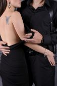 pic of nude couple  - Couple in evening dresses in an embrace  - JPG