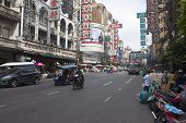 Vehicles pass along Yaowarat Road