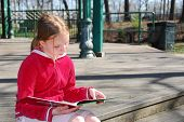 picture of young girls  - young girl reading a book outside - JPG