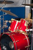 picture of drum-kit  - Image of red drum kit in recording studio - JPG
