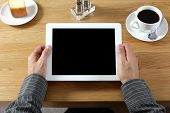 stock photo of cafe  - Digital tablet with blank screen in coffee shop cafe - JPG