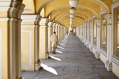 The arched colonnade with suspended lanterns in Gostiny Dvor, St. Petersburg