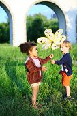picture of spinner  - The boy passes wind spinner to the girl - JPG