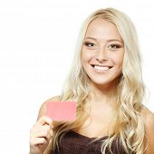 beautiful friendly smiling confident girl showing red card in hand, over white background