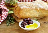 still life in the Italian style - ciabatta bread, olive and oil