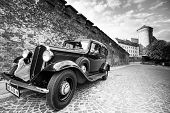 KRAKOW, POLAND - SEP 21: On territory of Royal palace in Wawel (b/w photo), Sep 21, 2013 in Krakow, Poland. The monument to the history of the Decree of the President Lech Walesa on September 8, 1994.