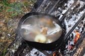 Preparing Fish Soup On The Fire During The Trip.