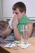 Sick Man With Tablets Ans Glass Of Water