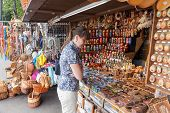 Novgorod - August 10: Young Woman Choose Russian Handmade Souvenirs At The Gift Shop On August 10, 2