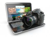 stock photo of private detective  - Digital photo camera and laptop - JPG