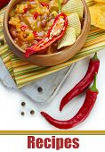 Chili Corn Carne - traditional mexican food, in wooden bowl, on napkin, isolated on white