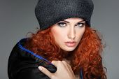 Portrait of sexual beautiful redheaded girl in a sportwear, is in fashion style