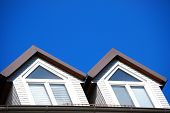 picture of gabled dormer window  - There are two dormers and a blue sky - JPG