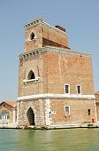 stock photo of arsenal  - One of the medieval fortress towers guarding the entrance to the Arsenale naval dockyard in Venice - JPG