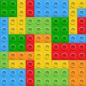 Plastic construction  blocks seamless background.