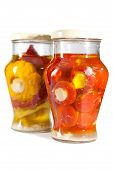 stock photo of marinade  - Marinaded tomatoes stuffed and bush pumpkins and vegetable marrows in a glass jar - JPG