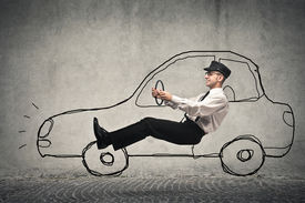 foto of designated driver  - driver driving on the road with a designed car - JPG