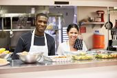 stock photo of homeless  - Portrait Of Kitchen Staff In Homeless Shelter - JPG