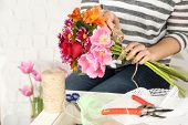 picture of compose  - Female hands composing beautiful bouquet - JPG