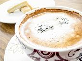 picture of shortbread  - Coffee cup close up and shortbread fingers in background - JPG