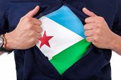 Young Sport Fan Opening His Shirt And Showing The Flag His Country Djibouti, Djiboutian Flag