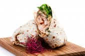 Chicken fajita tortilla wrap sandwich isolated on white