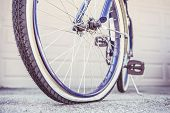 Bike with a flat tire, shallow focus