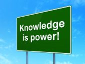 Education concept: Knowledge Is power! on road sign background