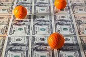 U.s.dollar Banknotes And Practice Golf Balls