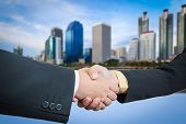 Businessman Handshake With Building Area Background