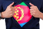 image of eritrea  - Young sport fan opening his shirt and showing the flag his country eritrea eritrean flag - JPG