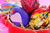 a pile of easter eggs painted in different colors and patterns