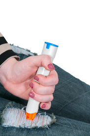 pic of anaphylaxis  - Woman injecting emergency medicine into her leg - JPG
