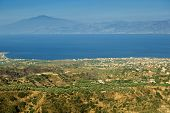 stock photo of messina  - Wonderful view from Aspromonte in Calabria on Messina and Etna through Messina strait - JPG