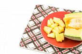 Cantaloupe On Red Dish