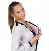 Portrait of woman removing blouse