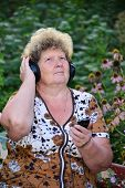 Mature woman listening to music