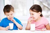 Girl And Boy Drink Tasty Fresh Milk