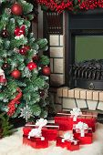 Christmas Tree, Fireplace And A Red Gift Boxes