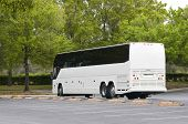 stock photo of motor coach  - New white Bus with tinted windows waiting for decaling and purchase