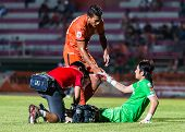 Sisaket Thailand-september 21: David Bala Of Sisaket Fc. (orange) In Action During Friendly Match Be