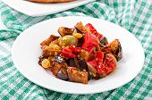 foto of pine nut  - caponata with raisins and pine nuts decorated with a leaf of basil - JPG