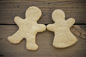 stock photo of ginger bread  - Happy Blank Ginger Bread Couple on Wooden Background Ginger Bread Cookies with Copy Space as Christmas or Winter Background - JPG