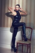 pic of catsuit  - Sexy woman in latex catsuit posing at vintage wall - JPG